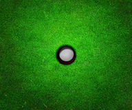 Ball in Hole Golf Background Stock Images