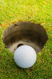 The ball at the hole Stock Image