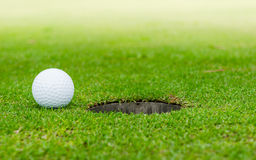 The ball at the hole Royalty Free Stock Images
