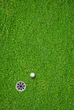 The ball at the hole on the golf course Royalty Free Stock Photos