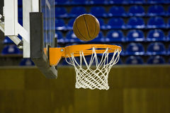 Ball in hoop. Close up on a basketball in hoop Royalty Free Stock Image