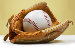 Ball In Kids Glove Royalty Free Stock Photo
