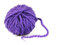 Ball of intense purple wool or yarn Royalty Free Stock Photos