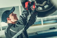Ball Joint Car Steering Fix. Ball Joint Vehicle Steering Maintenance by Professional Caucasian Car Mechanic. Automotive Industry stock image