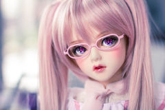 Ball jointed doll butterfly eyes. Ball-jointed doll with butterfly eyes royalty free stock photos