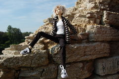 Ball-jointed doll emo sitting on the limestone. There is Ball-jointed doll emo sitting on the limestone royalty free stock image