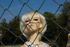Ball-jointed doll with squinting glance Royalty Free Stock Images