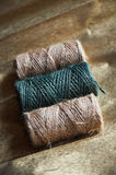 A ball of jute thick threads of brown and green.3 skeins royalty free stock image