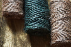 A ball of jute thick threads of brown and green.3 skeins stock photos