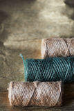 A ball of jute thick threads of brown and green.3 skeins stock images