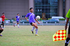 Ball kick from socker in thailand. Association football, more commonly known as football or soccer, is a sport played between two teams of eleven players with a royalty free stock photo