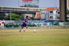 Ball kick from socker in thailand. Association football, more commonly known as football or soccer, is a sport played between two teams of eleven players with a stock photo
