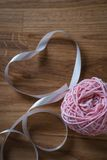 Ball of knitting yarn with ribbon Royalty Free Stock Images
