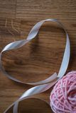 Ball of knitting yarn with ribbon Royalty Free Stock Photo