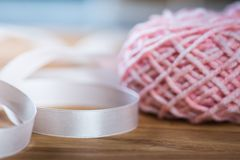 Ball of knitting yarn with ribbon Stock Images