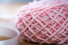 Ball of knitting yarn with ribbon Royalty Free Stock Photography