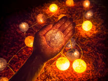 Ball of light in hand royalty free stock images