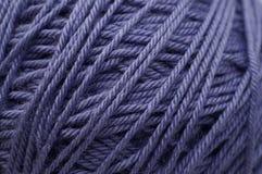 Ball of lilac yarn. Royalty Free Stock Photo
