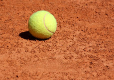 Ball lying on tennis court Royalty Free Stock Images