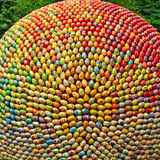 A ball made from lot multicolored easter eggs. Stock Images