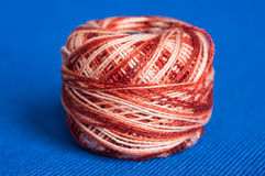 Ball of a melange yarn on a blue background Royalty Free Stock Photo