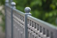 Ball metal part of fence, light background royalty free stock photography