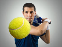 This ball is mine. Closeup of ball of with the paddle tennis player ready to hit Stock Photos