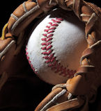 Ball in mitt. An old baseball sits in a mitt Stock Images