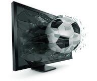 Ball through monitor Royalty Free Stock Photography