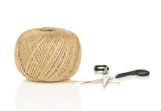 Ball of Natural String With Loose End and Scissors Royalty Free Stock Photos