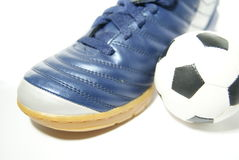 Ball near boot. Football shoe nad ball isolated on white Stock Photo