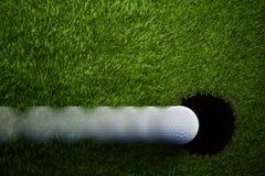 Ball near Hole Golf Background Stock Photo