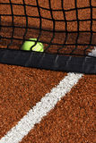 Ball in the net. And court with red line Royalty Free Stock Photo