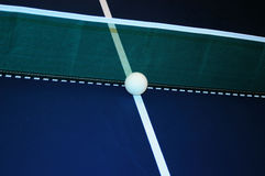 Ball a the net. Ball at the net on a ping pong table Stock Images