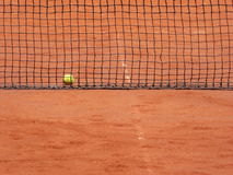 Ball and net on the clay tennis court Stock Image