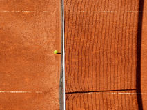 Ball and net on the clay tennis court Royalty Free Stock Photo