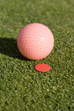Ball Next To Marker On Green - Vertical Royalty Free Stock Photo
