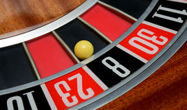 Ball in number eight. Ball in winning number eight at roulette wheel royalty free stock image