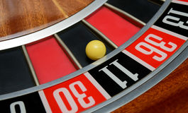 Ball in number eleven. Ball in winning number eleven at roulette wheel royalty free stock photos