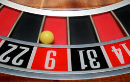 Ball in number nine. Ball in winning number nine at roulette wheel stock images