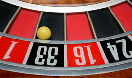 Ball in number thirty-three. Ball in winning number thirty three at roulette wheel royalty free stock images