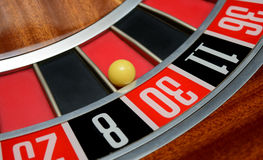 Ball in number thirty. Ball in winning number thirty at roulette wheel stock photo