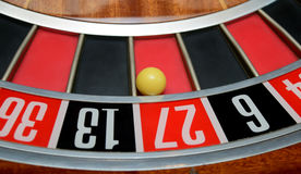 Ball in number twenty seven. Ball in winning number twenty seven at roulette wheel Royalty Free Stock Images