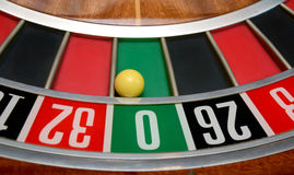 Ball in number zero. Ball in winning number zero at roulette wheel stock photos
