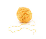 Ball of orange yarn Stock Images
