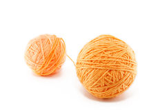 Ball of orange yarn Royalty Free Stock Image