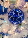 Blue and White Ornament in Christmas Tree Stock Photos