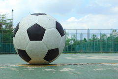 Ball on the outdoor futsal court Royalty Free Stock Photo