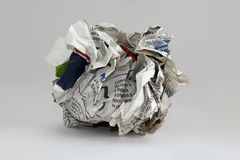 Ball of paper on the bottom. Ball of crumpled paper, on white and round Royalty Free Stock Photos