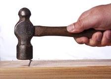 Ball peen Hammer misses the head of a nail Stock Photos